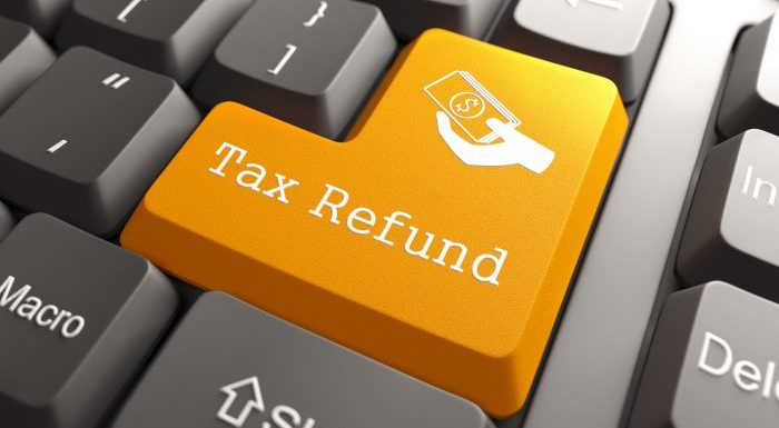 Tax Refund - Orange Button on Computer Keyboard. Internet Concept.