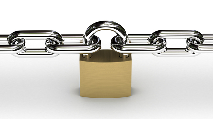 Padlock securing two chains over white background