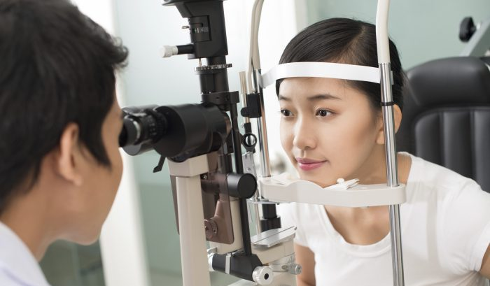 Pretty girl undergoing medical examination at the oculist's