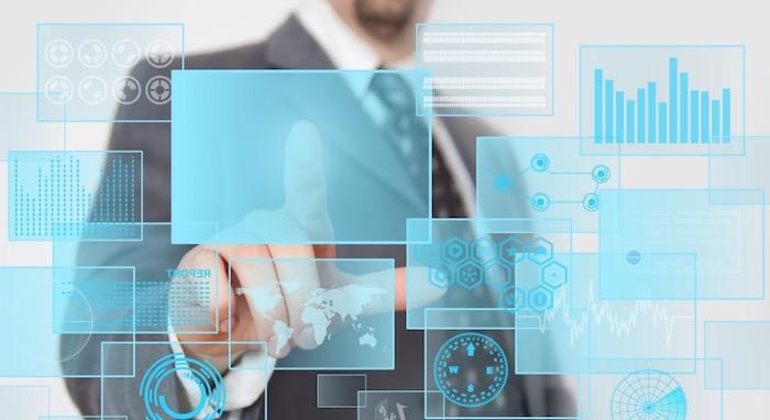Man pressing digital button in a futuristic touchscreen monitor